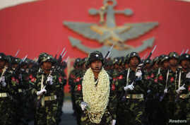 Soldiers salute Burma's army chief General Min Aung Hlaing during a parade in Naypyitaw, March 27, 2012.