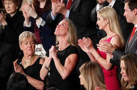 """Carryn Owens, widow of widow of Navy SEAL William """"Ryan"""" Owens, is applauded on Capitol Hill in Washington, Feb. 28, 2017, as she was acknowledged by President Donald Trump during his address to a joint session of Congress."""