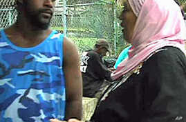 A member of Project Downtown talks to a homeless man in Tampa, Florida