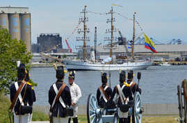To kick off the 200th anniversary of the War of 1812, ships from around the world sailed past Fort McHenry and exchanged canon fire with re-enactors on land, but it was all for show. (S. Logue/VOA)