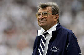 Penn State coach Joe Paterno watches the college football game against Youngstown State from the side lines Saturday, Sept. 16, 2006,  in State College, Pa..