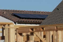 Solar panels are seen on the rooftop on a home in a new housing project in Sacramento, Calif., May 7, 2018.