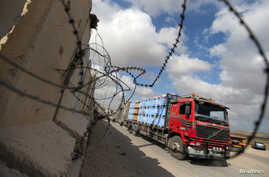 A truck carrying goods arrives at Kerem Shalom crossing in Rafah in the southern Gaza Strip Aug. 15, 2018.