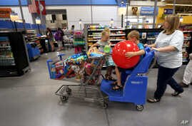 FILE - A family shops at the Wal-Mart Supercenter in Springdale, Arkansas, June 4, 2015.