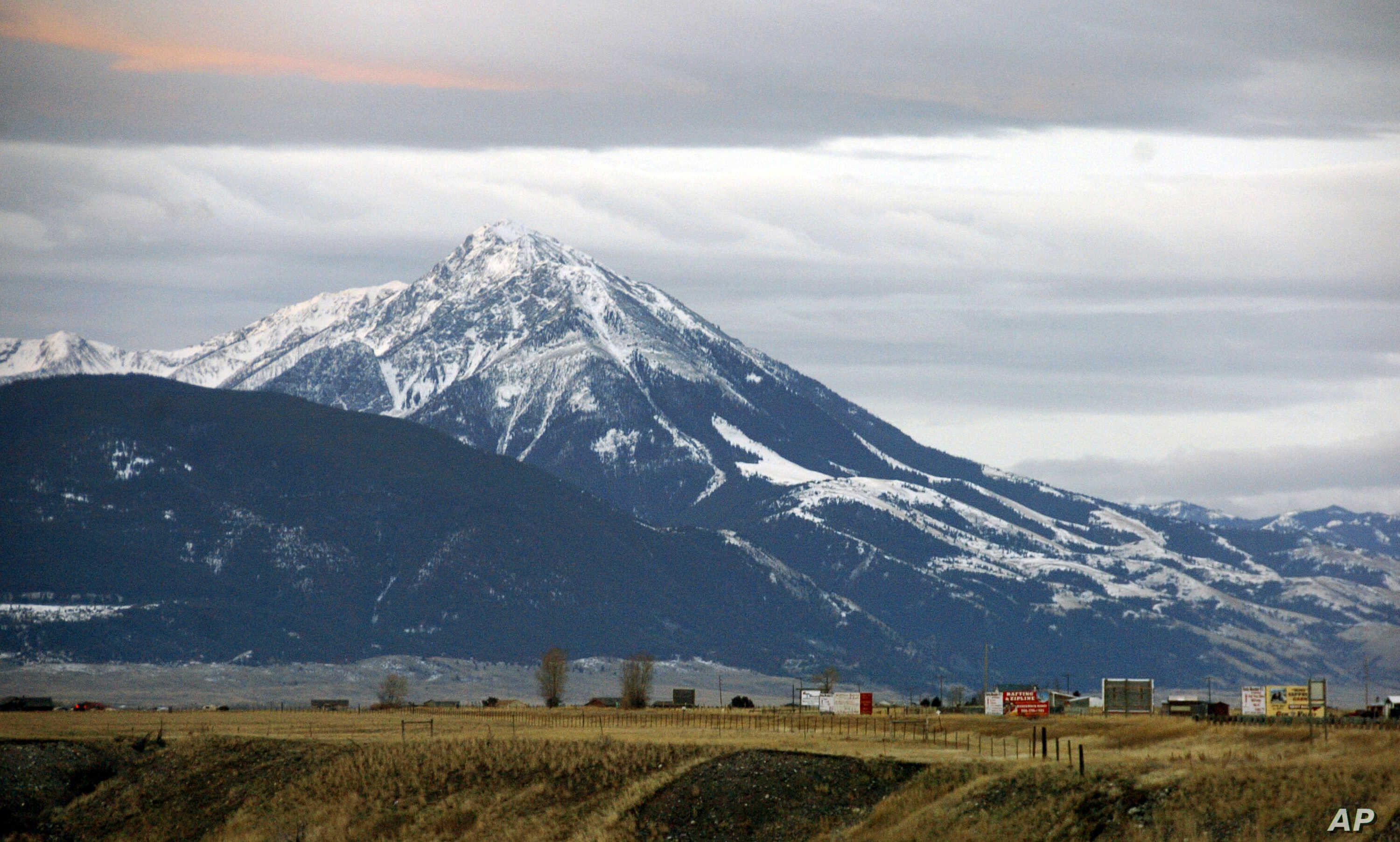 FILE - Emigrant Peak towers over the Paradise Valley in Montana north of Yellowstone National Park, Nov. 21, 2016.
