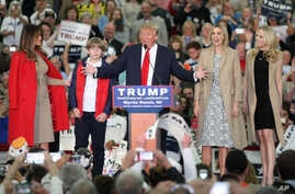 Republican presidential candidate Donald Trump, middle, speaks near his wife, Melania, left, son Baron, daughter Ivanka, second from right, and daughter Tiffany during a campaign event at the Myrtle Beach Convention Center on Nov. 24, 2015, in Myrtle