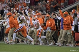 Clemson Tigers players celebrate on the field after defeating the Alabama Crimson Tide in the 2017 College Football Playoff National Championship Game at Raymond James Stadium, Jan. 9, 2017.