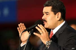 Venezuela's President Nicolas Maduro, delivers his speech during the new military chief's swearing-in ceremony at the Fort Tiuna military base in Caracas, Oct. 27, 2014.