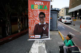 Election campaign posters of Erika Farias, government candidate for mayor of Libertador district, hang in Caracas, Venezuela, Dec. 8, 2017.