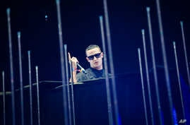 FILE - DJ Snake performs at the 2015 Coachella Music and Arts Festival.