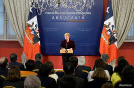 "Chile's President Michelle Bachelet delivers a message asking for forgiveness from indigenous Mapuche people for ""errors and horrors"" committed by the state and announcing plans to give them more power and resources, at the government house in Santia"