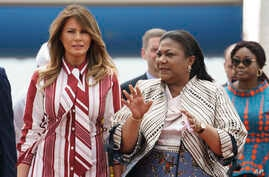 First lady Melania Trump walks with Ghana's first lady Rebecca Akufo-Addo as she arrives at Kotoka International Airport in Accra, Ghana, Oct. 2, 2018.