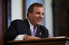 New Jersey Gov. Chris Christie laughs at a question from the media after speaking in Trenton, N.J. Donald Trump is pledging that the government he appoints will bring sweeping change to Washington's culture, Aug. 29, 2016 file photo.