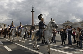 Enthusiasts wearing period uniforms of Russian cavalry and infantry from 1812 march through the Palace Square in St. Petersburg, Russia, August 25, 2012.