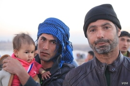 Once a farmer from Mosul, Ibrahim Inaimy (R) fled to the Hassan Sham camp in Iraqi Kurdistan last week, saying Islamic State militants were brutalizing the people as the Iraqi Army recently closed in before taking his area, on Dec. 7, 2016. (H.Murdoc...