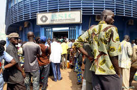 People wait in line at the BSIC bank in in Bangui December 31, 2012.