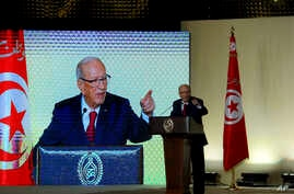 Tunisian President Beji Caid Essebsi gestures during a speech in Tunis, May 10, 2017. Tunisia's president has taken the unusual step of ordering the army to protect businesses struggling because of weeks of protests over unemployment and corruption.