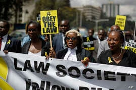 Mercy Wambua (C), CEO of the Law Society of Kenya, and other lawyers march to demand that court orders and the law are respected, following the government's deportation last week of an opposition politician in defiance of a court order that he be pro