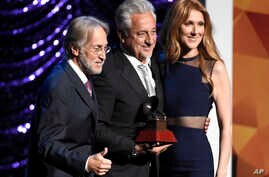 Neil Portnow, president and CEO of the Recording Academy, from left, Trustees Award recipient Humberto Gatica and Celine Dion pose on stage at the Lifetime Achievement and Trustees Awards presentation at the Ka Theater in the MGM Grand Hotel, Nov. 18