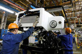 FILE - Workers assemble trucks at GAZ car factory in Nizhny Novgorod, Russia, June 17, 2009.