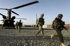US infantrymen from the 101st Airborne Division and Afghan Army commandos exit a U.S. Army helicopter used to transport troops around Zhari District in Afghanistan's southern Kandahar province, 11 Sept. 2010.