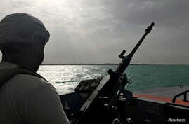 FILE - A UAE navy soldier patrols at Al-Mokha port in Yemen, March 6, 2018.
