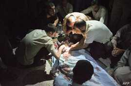 Syrians mourn over Mohammed Hafez, 30, who was killed by a gunshot to the head in Izaz, July 13, 2012