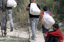 More Syrians Flee to Turkey After Troops Retake Northern Town