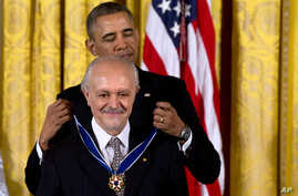 President Barack Obama awards chemist, and Nobel Prize winner Mario Molina with the Presidential Medal of Freedom during a ceremony in the East Room of the White House in Washington, Nov. 20, 2013.
