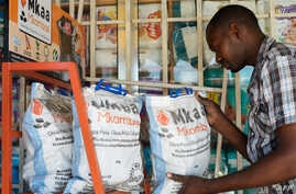 FILE - stocks environmentally friendly charcoal at his shop in Dar es Salaam on March 10, 2015.