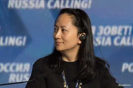 "Meng Wanzhou, Executive Board Director of the Chinese technology giant Huawei, attends a session of the VTB Capital Investment Forum ""Russia Calling!"" in Moscow, Oct. 2, 2014."
