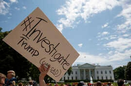 Demonstrators gather outside the White House in support of an investigation of Donald Trump, May 10, 2017.