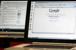 FILE - This Oct. 14, 2004 file photo shows computers displaying the Google Desktop search engine at the Digitallife show at New York's Jacob K. Javitz convention center.