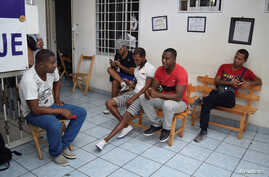 Cubans stranded in Mexico chat at a hotel after fellow nationals were deported in Tapachula, Mexico, Jan. 20, 2017.