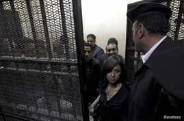 People accused of working for unlicensed non-governmental organizations awaiting trial hearings in a cage, Cairo, March 8, 2012.
