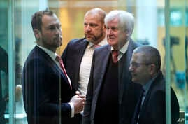 Bavarian governor and head of the Christian Social Union Horst Seehofer stands in an elevator prior to the talks on forming a new German government between Angela Merkel's Christian Democratic bloc and the Social Democratic party in Berlin, Germany,