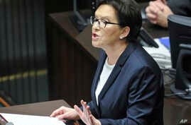 Outgoing Polish Prime Minister Ewa Kopacz delivers her resignation speech during the first session of the newly elected parliament Nov. 12, 2015, in Warsaw, Poland.
