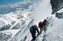 FILE - A team of mountaineers is seen climbing Mount Everest.