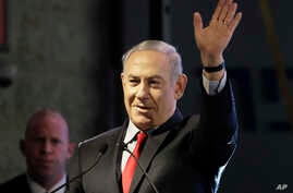 Israeli Prime Minister Benjamin Netanyahu waves during the opening ceremony for a bomb-proof emergency room in a hospital in Ashkelon, Israel, Feb. 20, 2018.