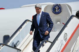 U.S. Secretary of State John Kerry steps off his plane upon his arrival at the Queen Alia International Airport in Amman, Jordan, July 16, 2013.