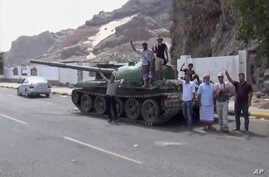 This frame grab from video shows fighters loyal to the separatist so-called Southern Transitional Council, backed by the United Arab Emirates, near the presidential palace, in Aden Yemen, Tuesday, Jan. 30, 2018.