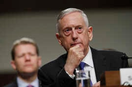FILE - Defense Secretary Jim Mattis listens while testifying before the Senate Armed Services Committee hearing on the Pentagon's budget, on Capitol Hill in Washington, June 13, 2017.