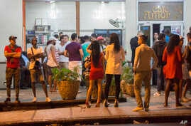 People stand in the street after nightclubs were closed by authorities in Havana, Cuba, early Saturday, Nov. 26, 2016. Former President Fidel Castro, who led a rebel army to improbable victory in Cuba, embraced Soviet-style communism and defied the p