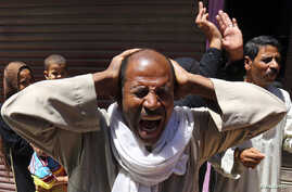 Relatives and families of members of the Muslim Brotherhood and supporters of ousted Egyptian President Mohamed Mursi react outside a court in Minya, south of Cairo, after the sentences of Muslim Brotherhood leader Mohamed Badie and his supporters we