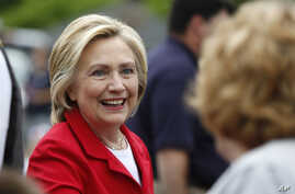 Democratic presidential candidate Hillary Clinton greets a spectator at a Fourth of July parade in Gorham, N.H., July 4, 2015.
