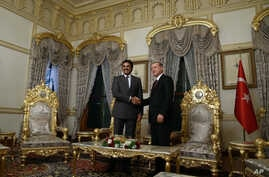 FILE - Turkish President Recep Tayyip Erdogan, right, and Qatar's Emir Sheik Tamim bin Hamad Al Thani shake hands as they pose for a photo at the Mabeyn Palace, one of old Ottoman palaces in Istanbul, Friday, Feb. 12, 2016.