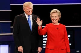 FILE- Republican presidential nominee Donald Trump and Democratic presidential nominee Hillary Clinton are introduced during the first presidential debate at Hofstra University in Hempstead, N.Y., Sept. 26, 2016.