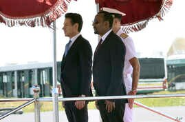 Italian Premier Giuseppe Conte, left, and Ethiopian Prime Minister Abiy Ahmed Ali stand attention at they review the guard of honor, in Addis Ababa, Ethiopia, on the occasion of an official visit, Oct. 11, 2018.