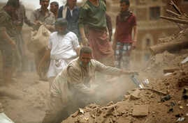 People search for survivors under the rubble of houses destroyed by Saudi airstrikes in the old city of Sana'a, Yemen, June 12, 2015.