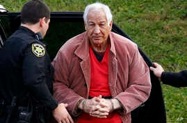 Former Penn State University assistant football coach Jerry Sandusky arrives for an appeal hearing at the Centre County Courthouse in Bellefonte, Pennsylvania on October 29, 2015. Penn State was fined $2.4 million for failing to warn students and emp